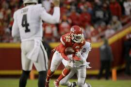 Kansas City Chiefs safety Juan Thornhill (22) intercepts a pass intended for Oakland Raiders wide receiver Keelan Doss (18) during the first half of an NFL football game in Kansas City, Mo., Sunday, Dec. 1, 2019. (AP Photo/Charlie Riedel)