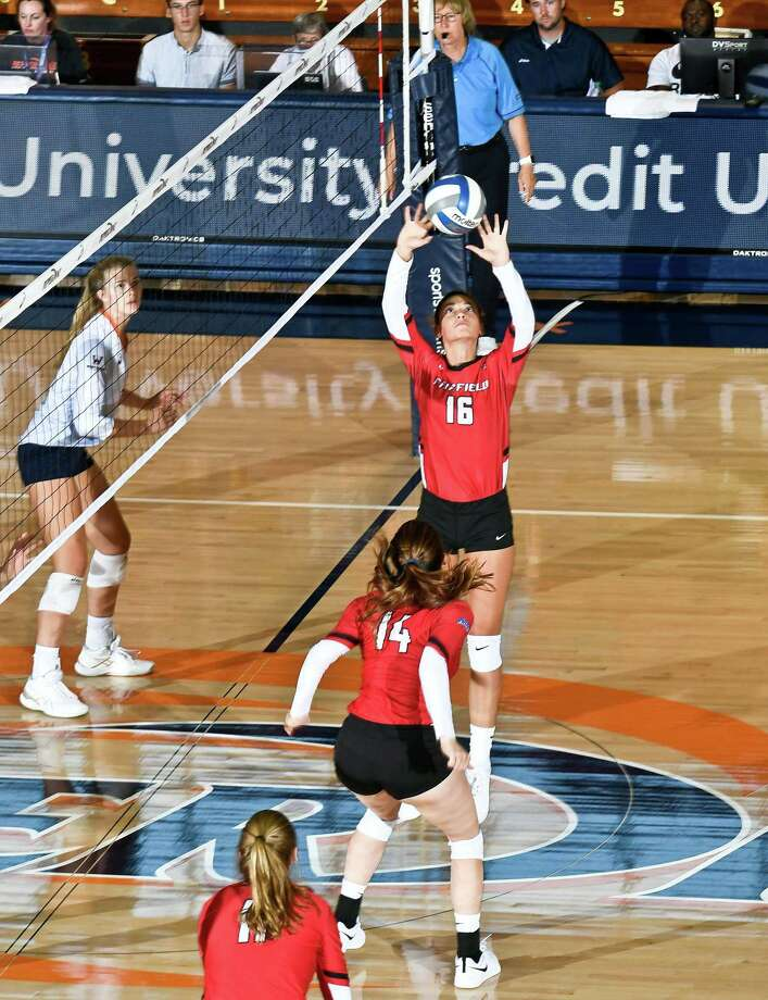 Manuela Nicolini (16), Kaylie Butts (14) and Laura Seeger (11) led Fairfield to the MAAC volleyball title and spot in NCAA tournament last season Photo: Contributed Photo