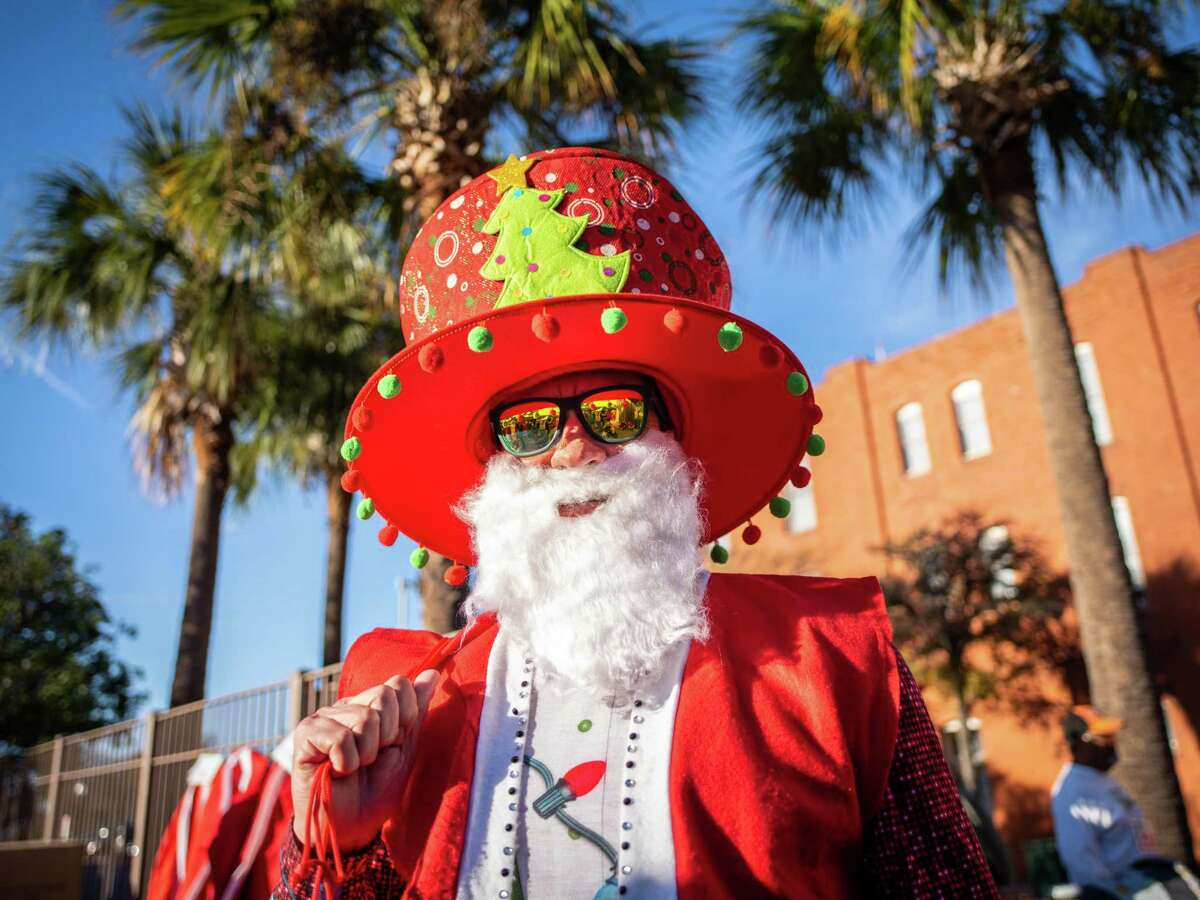 Adrian Estrada arrives for the ninth annual Santa Antonio 5K run in San Antonio on Sunday. Proceeds from the event go to MD Anderson to fund cancer research. Over the past eight years, the event has raised $230,000 for MD Anderson.