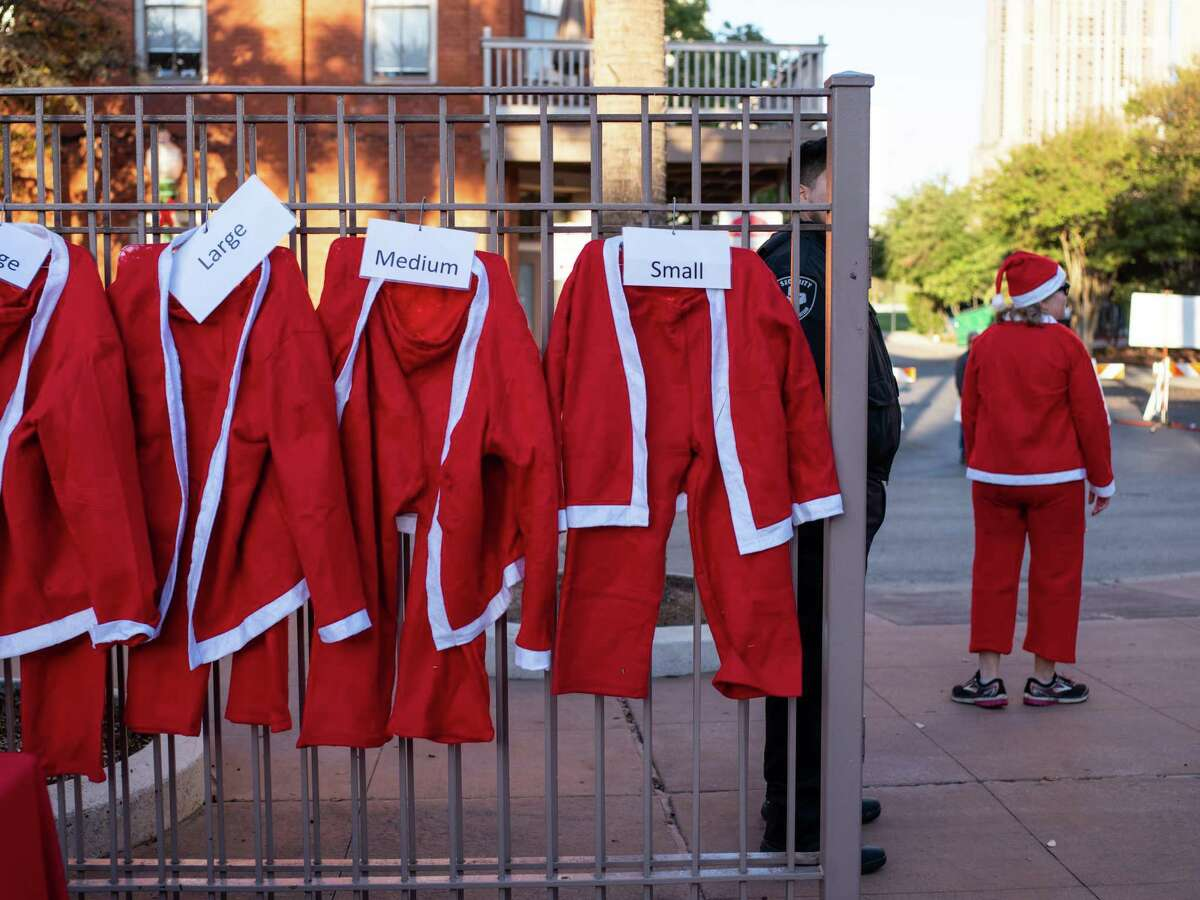 Santa suits are handed out during the 9th annual Santa Antonio 5k run in San Antonio, Texas on Sunday, December 1, 2019. Proceeds from the event go to MD Anderson to fund cancer research. Over the past 8 years the event has raised $230,000 for MD Anderson. ?'It?•s real touching to see support from the communityÉ[and from] people touched by cancer,?