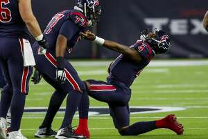 Houston Texans quarterback Deshaun Watson (4) reacts after throwing a touchdown pass during the third quarter of an NFL football game at NRG Stadium on Sunday, Dec. 1, 2019, in Houston.