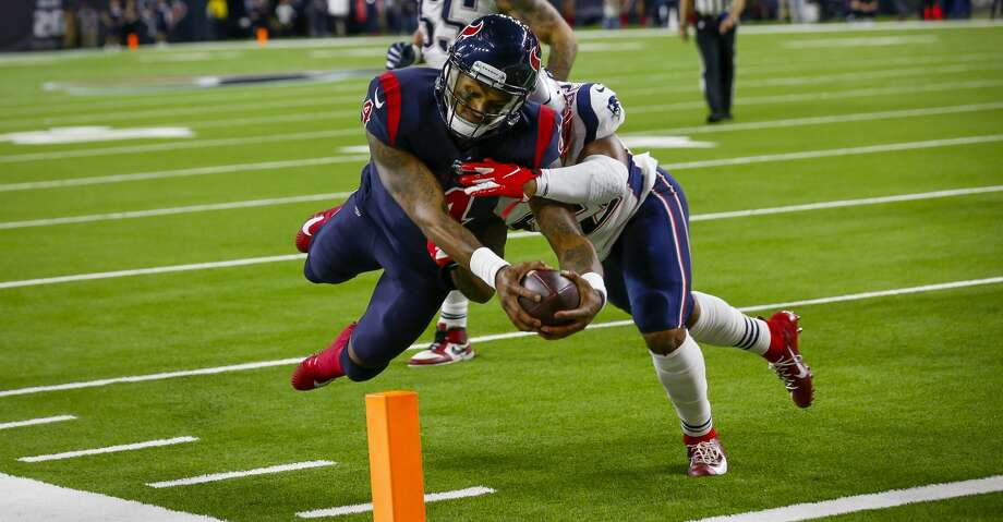 Houston Texans quarterback Deshaun Watson (4) dives into the end zone after a six-yard touchdown pass from Houston Texans wide receiver DeAndre Hopkins (10) during the fourth quarter of an NFL football game at NRG Stadium on Sunday, Dec. 1, 2019, in Houston. Photo: Brett Coomer/Staff Photographer