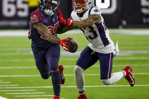 Houston Texans running back Duke Johnson (25) is pushed out of bounds by New England Patriots strong safety Patrick Chung (23) during the fourth quarter of an NFL football game at NRG Stadium on Sunday, Dec. 1, 2019, in Houston.