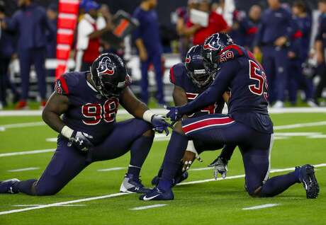 Houston Texans defensive end D.J. Reader (98), linebacker Jake Martin (54) and outside linebacker Whitney Mercilus (59) celebrate a stop during the fourth quarter of an NFL football game at NRG Stadium on Sunday, Dec. 1, 2019, in Houston.