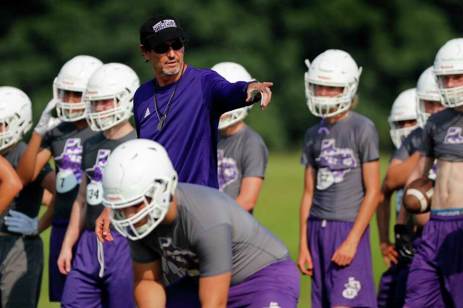 In this Aug. 5, 2019, photo, head coach Art Briles instructs his team during a practice at Mount Vernon High Schoo in Mount Vernon, Texas. Most of the town's residents knew nothing about the possibility of Briles becoming coach until the school board unanimously approved his hiring in a special meeting on the Friday night going into Memorial Day weekend. (AP Photo/Tony Gutierrez) Photo: Tony Gutierrez, STF / Associated Press / Copyright 2019 The Associated Press. All rights reserved.