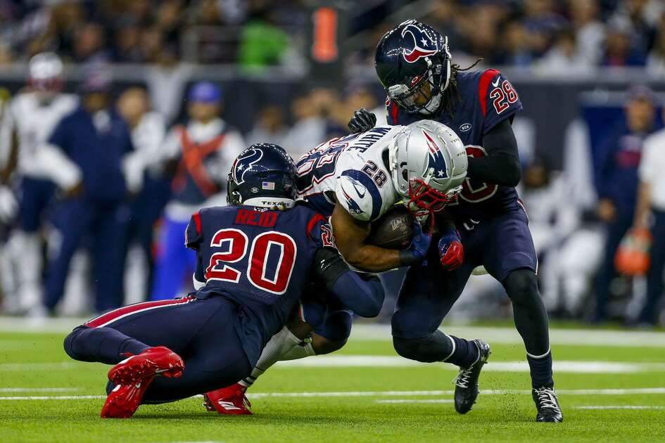 Houston Texans strong safety Justin Reid (20) and cornerback Vernon III Hargreaves (28) tackle New England Patriots running back James White (28) during the fourth quarter of an NFL game at NRG Stadium Sunday, Dec. 1, 2019, in Houston.