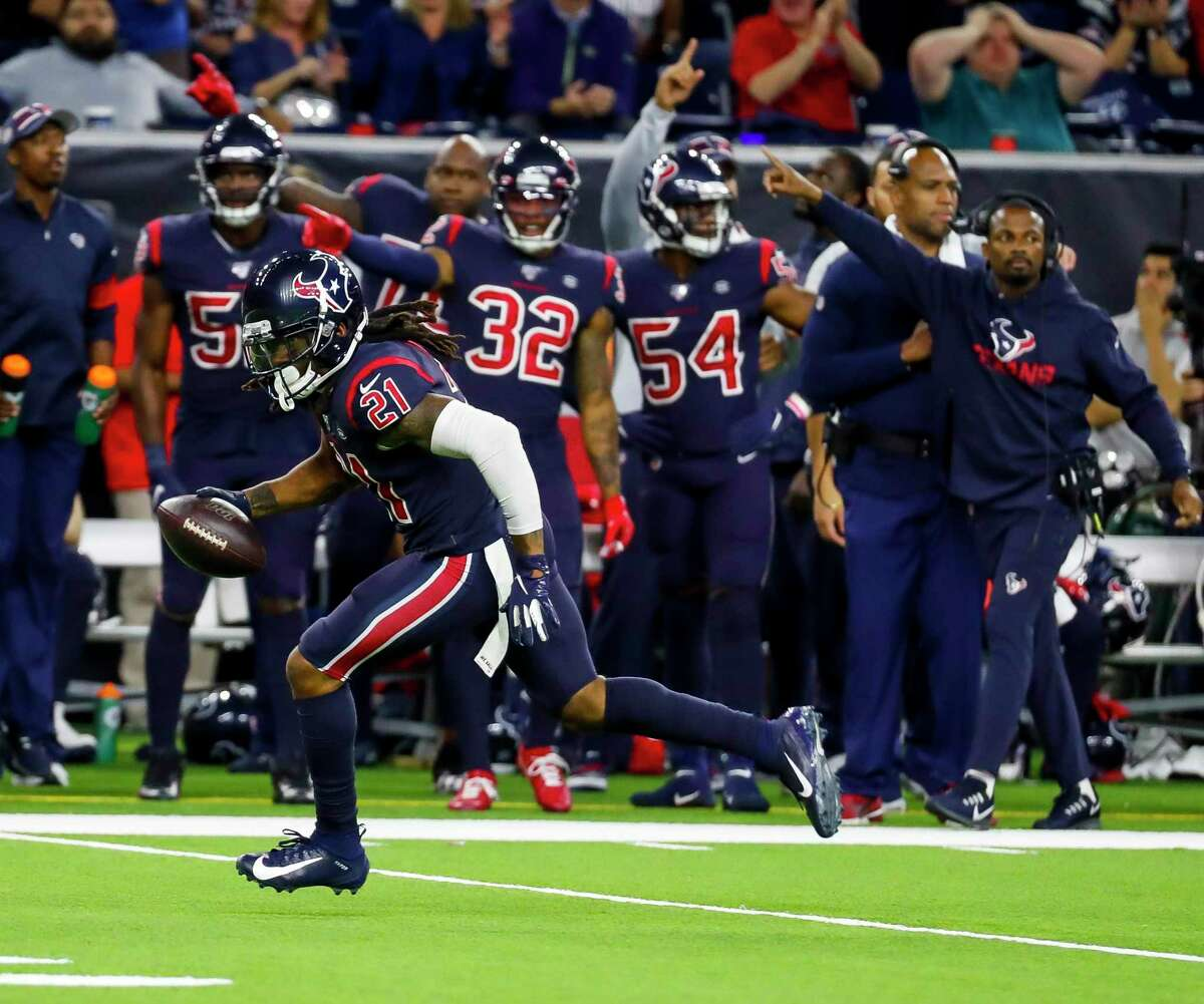 Texans cornerback Bradley Roby (21) runs back an interception that was called back after a defensive holding call during a game Sunday at NRG Stadium.