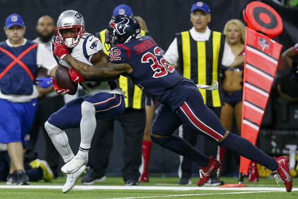 New England Patriots wide receiver Phillip Dorsett (13) makes a catch against Houston Texans cornerback Lonnie Johnson (32) during the fourth quarter of an NFL game at NRG Stadium Sunday, Dec. 1, 2019, in Houston.