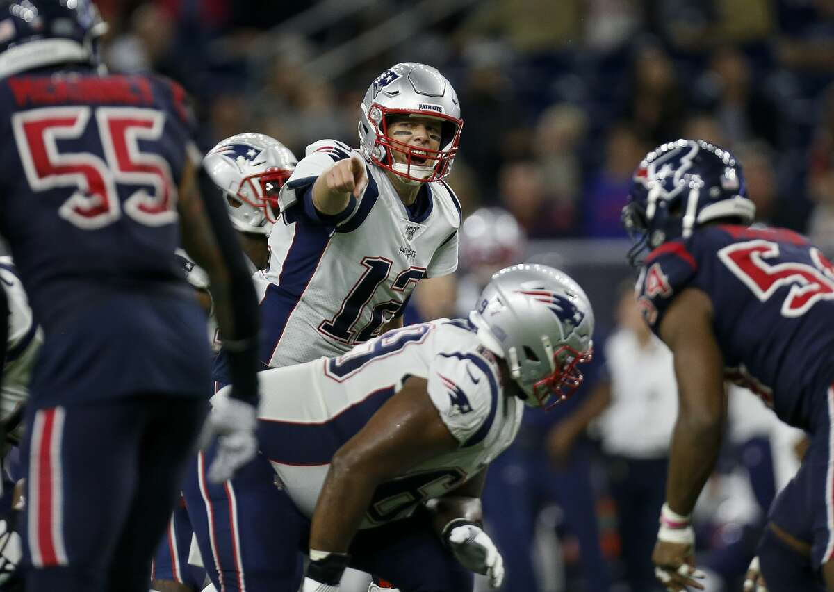 New England Patriots quarterback Tom Brady (12) signals toward the Houston Texans defense during the fourth quarter of an NFL game at NRG Stadium Sunday, Dec. 1, 2019, in Houston.