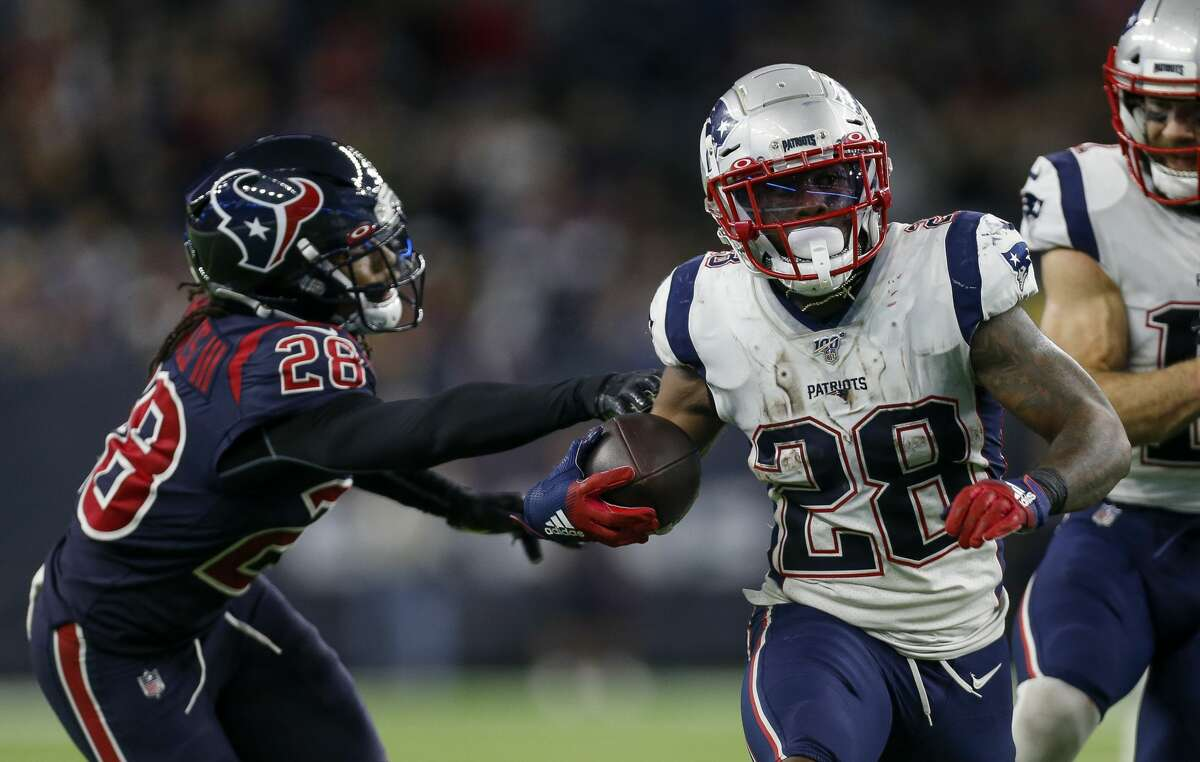 New England Patriots running back James White (28) runs he ball against the Houston Texans during the fourth quarter of an NFL game at NRG Stadium Sunday, Dec. 1, 2019, in Houston.