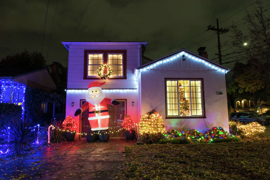 The 3200 block of Thompson Avenue in Alameda is often referred to as Christmas Tree Lane, a neighborhood with 55 houses that put your simple string of white lights to shame every December. Photo: Blair Heagerty / SFGate