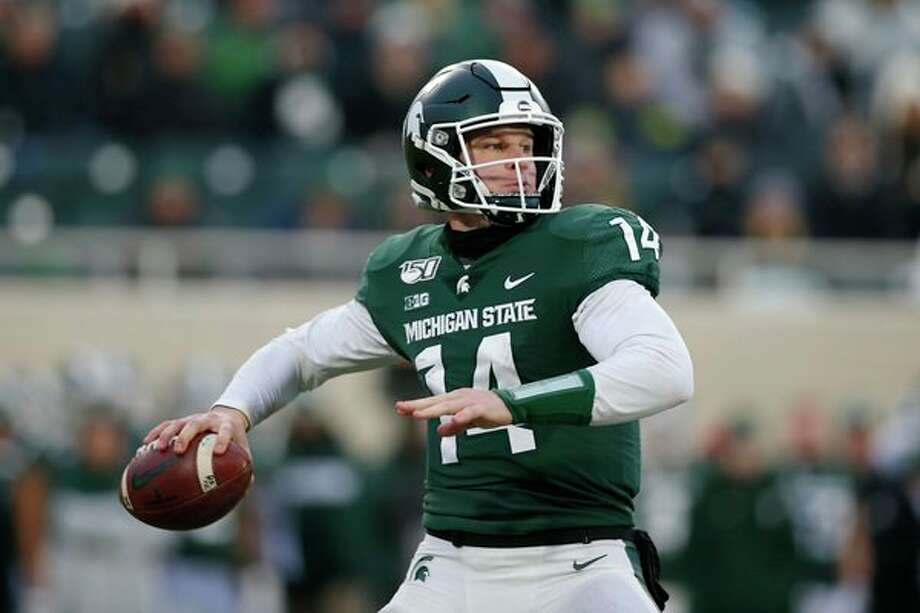 Michigan State quarterback Brian Lewerke looks to throw against Maryland during the first half of an NCAA college football game, Saturday, Nov. 30, 2019, in East Lansing, Mich. (AP Photo/Al Goldis) / Copyright 2019 The Associated Press. All rights reserved