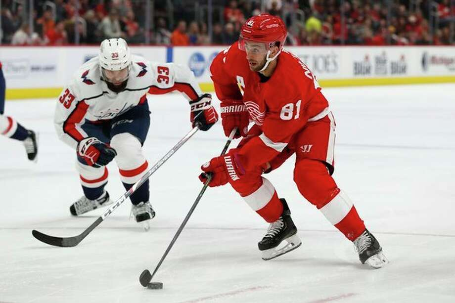 Detroit Red Wings center Frans Nielsen (81) controls the puck next to Washington Capitals defenseman Radko Gudas (33) during the second period of an NHL hockey game Saturday, Nov. 30, 2019, in Detroit. (AP Photo/Carlos Osorio) / Copyright 2019 The Associated Press. All rights reserved.