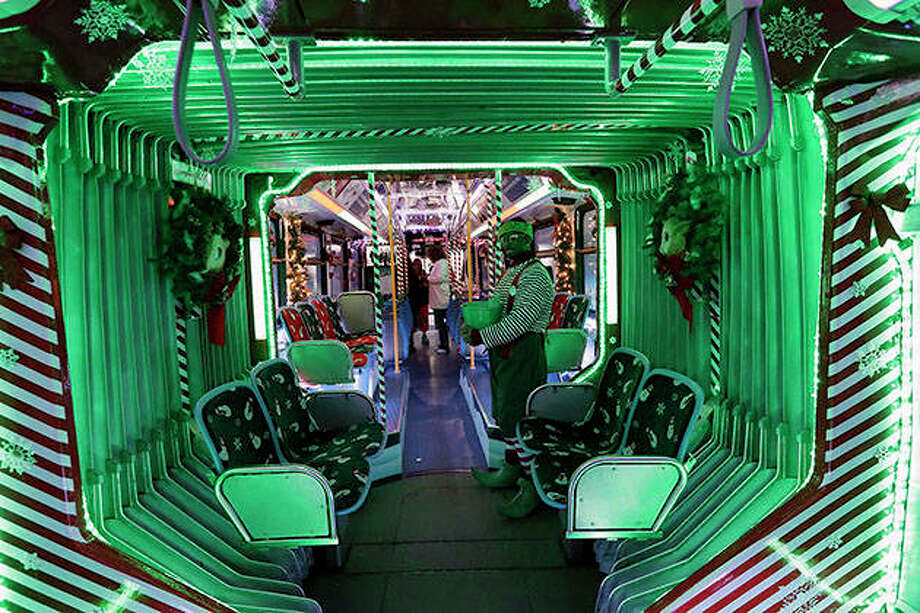 A CTA holiday bus makes a stop in Skokie. The bus operates on 15 different routes throughout Chicago during the holiday season. The bus exterior features Ralphie the Reindeer with his bright green nose. The interior features artwork created by students at Perkins Bass Elementary School. Photo: Nam Y. Huh | AP