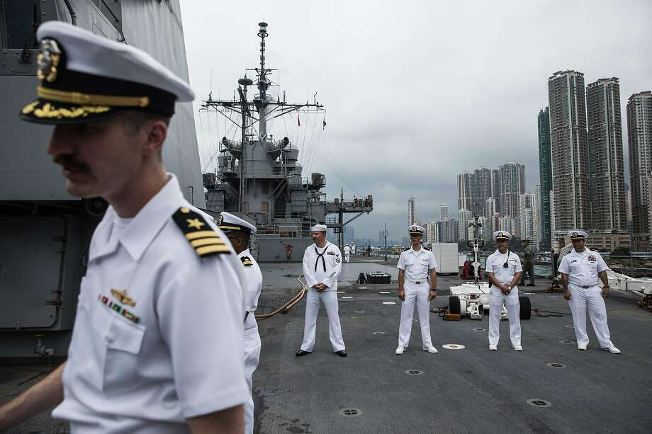 U.S. Navy crew members stand on the deck of the Blue Ridge during an April 20 port call in Hong Kong. Photo: DALE DE LA REY / AFP Via Getty Images