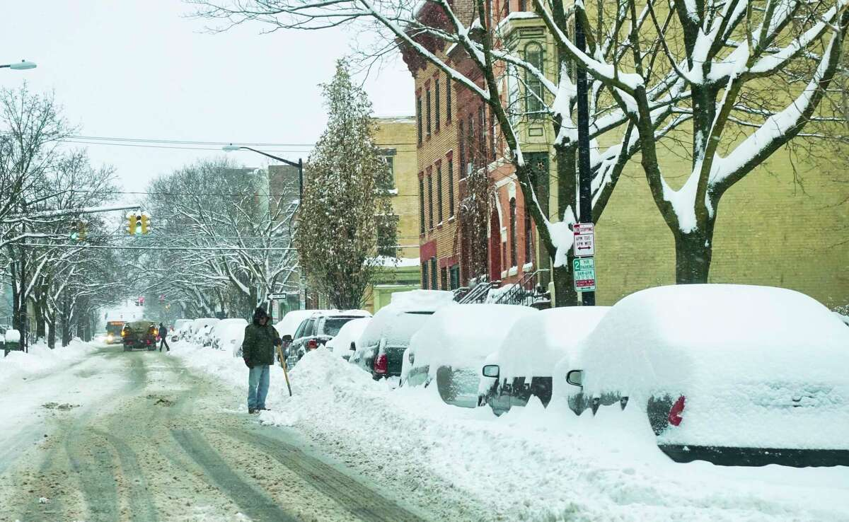 People begin digging out from the snow that fell Sunday and overnight on Monday, Dec. 2, 2019, in Albany, N.Y. (Paul Buckowski/Times Union)