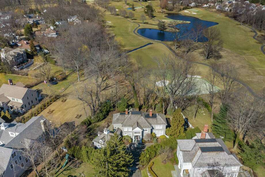 The shingle-style colonial at 21 Tomac Ave. in Old Greenwich is listed by Berkshire Hathaway HomeServices, New England Properties, for $2.85 million. The property enjoys views of the nearby Innis Arden golf course. Photo: Daniel Milstein Photography / Contributed Photo / 2019 Daniel Milstein Photography