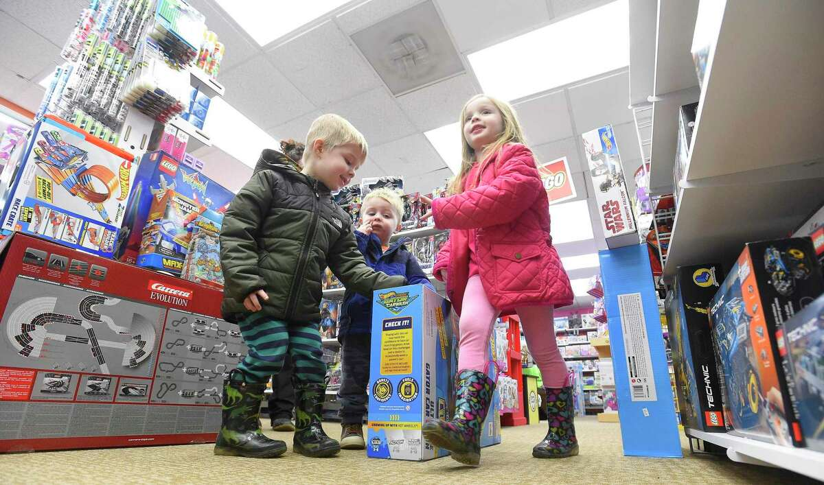 Kids checkout the merchandise at Awesome Toys and Gifts in Stamford, Conn., on Black Friday, Nov. 29, 2019.
