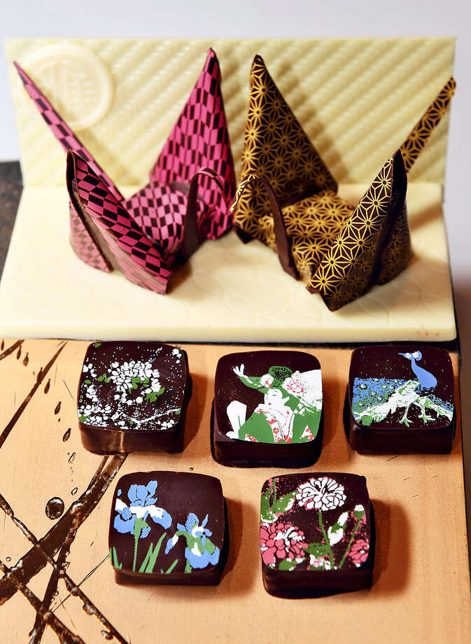 Hotel Gajoen Tokyo in Meguro Ward, Tokyo, offers a pair of origami chocolate cranes, background, and a set of five pieces featuring some of the hotel's ceiling paintings. Photo: Japan News-Yomiuri / Japan News-Yomiuri
