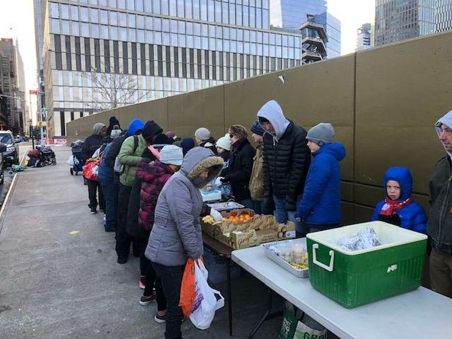 Congregation Shir Shalom volunteers feed the hungry at the synagogue's annual Breakfast Run in New York City. Photo: Amy Margulies.