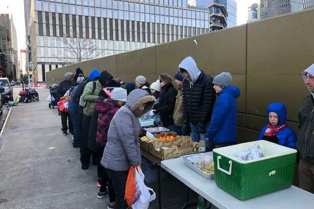 Congregation Shir Shalom volunteers feed the hungry at the synagogue's annual Breakfast Run in New York City.