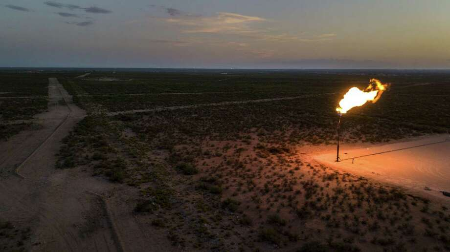 An aerial photograph of a flare at dusk near Mentone. The Oil and Gas Climate Initiative issued its 2019 report on methane and carbon intensity, reporting members continue to reduce their intensity and plan deeper cuts by 2025. Photo: Bloomberg Photo By Bronte Wittpenn. / © 2019 Bloomberg Finance LP