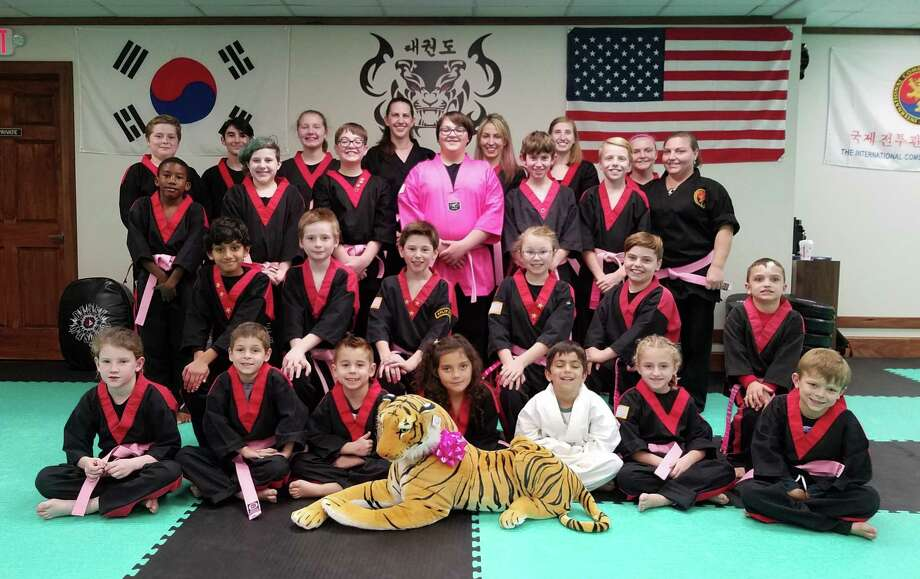 Students at American Tiger Martial Arts in Bethel helped raise money and awareness for breast cancer by purchasing a pink belt to be worn in class. Photo: Contributed Photo / The News-Times Contributed