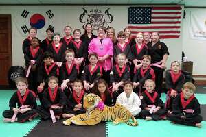 Students at American Tiger Martial Arts in Bethel helped raise money and awareness for breast cancer by purchasing a pink belt to be worn in class.