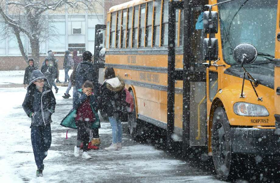 Students board buses at West Rocks Middle School during an ealry dismissal because of snow on Tuesday January 31, 2017 in Norwalk Conn Photo: Alex Von Kleydorff / Hearst Connecticut Media / Connecticut Post