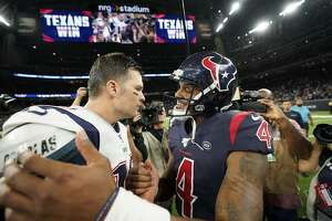 New England Patriots quarterback Tom Brady (12) and Houston Texans quarterback Deshaun Watson (4) after an NFL football game Sunday, Dec. 1, 2019, in Houston. (AP Photo/David J. Phillip)