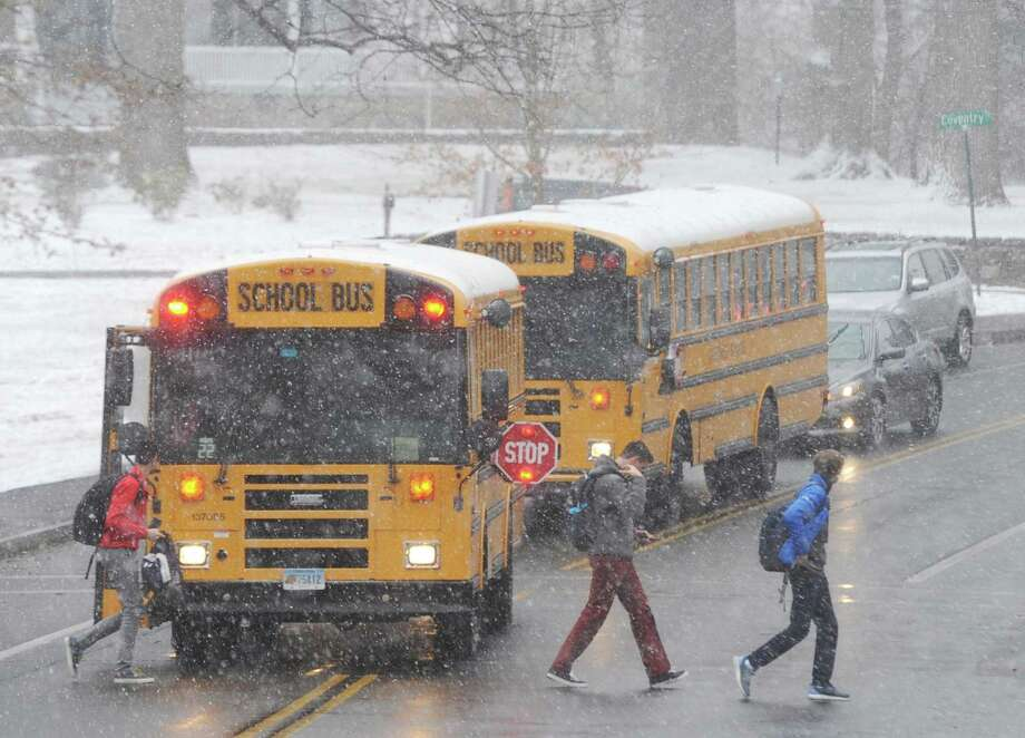 Students exit a school bus near Eastern Middle School after an early dismissal due to snow in the Riverside section of Greenwich, Conn. Tuesday, Jan. 31, 2017. Photo: File / Tyler Sizemore / Hearst Connecticut Media / Greenwich Time
