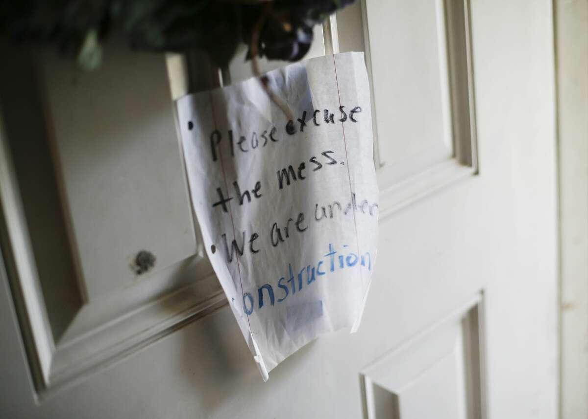 A sign on the door of Trinidad Hernandez's home near the Greens Bayou on Thursday, November 21, 2019 in Houston.