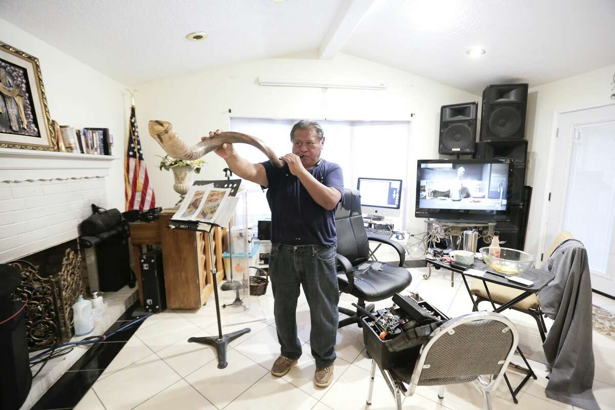 Trinidad Hernandez plays a shofar in his home on Thursday, November 21, 2019 in Houston. Hernandez is renovating his home and started a church in it after it got four feet of water in it following Harvey.