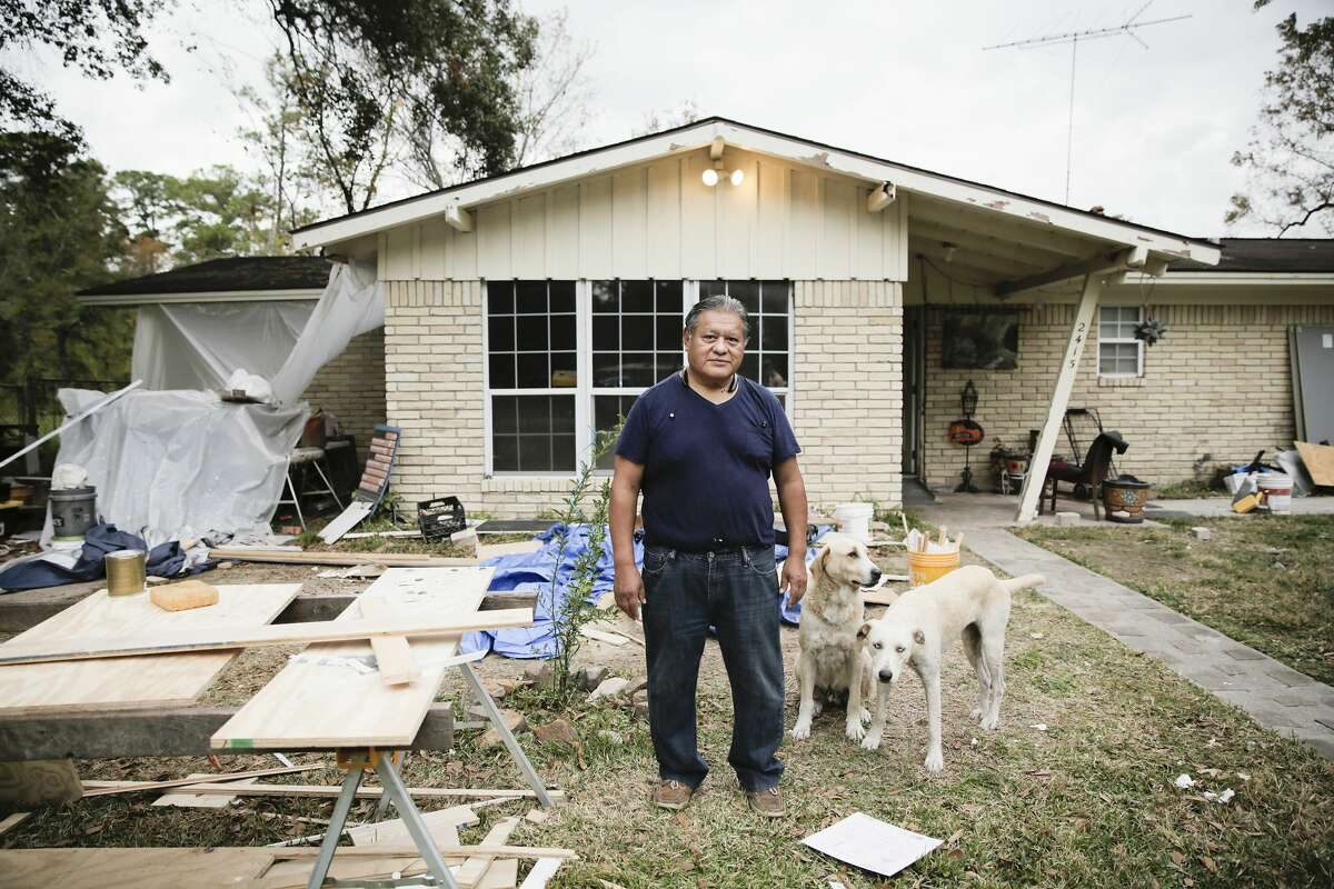 Trinidad Hernandez stands outside his Northeast Houston home in a neighborhood that is part of Harris County's buyout program on Thursday, November 21, 2019.