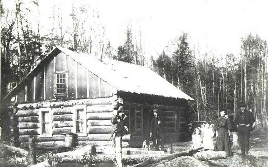 A pioneer cabin of the type visited by our winter traveler in 1881.