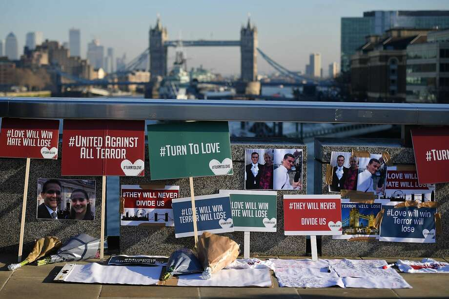 Banners and tributes form a memorial on London Bridge for the victims of Friday's terror attack that killed two people — Saskia Jones and Jack Merritt — and injured three others. Photo: Daniel Leal-Olivas / AFP Via Getty Images