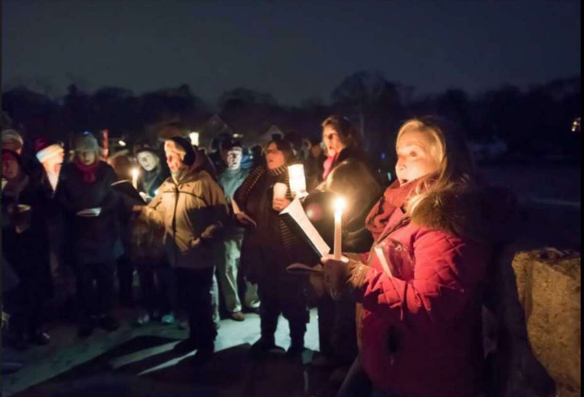 A scene from the first Friends of Gorham's Pond caroling at Rings End Bridge in Darien in 2017. It will return to the Pond this year after moving to Pear Tree Point Beach in 2018.