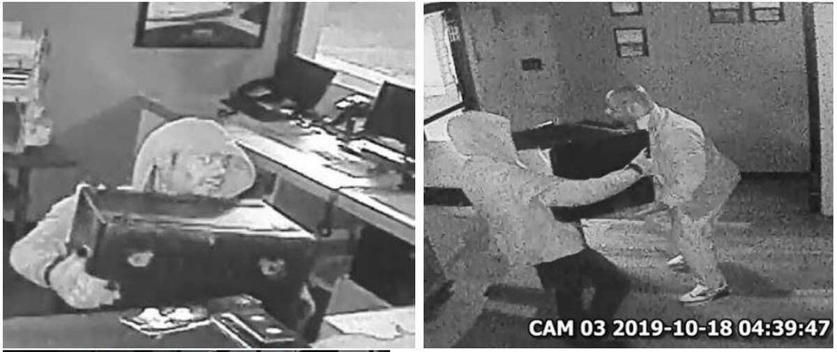 Two men are seen in surveillance video stills while allegedly breaking into a pizza shop on Glen Loch Drive in The Woodlands.