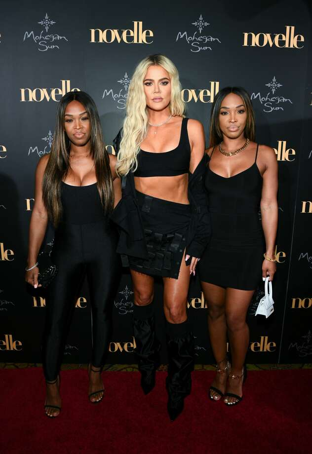 UNCASVILLE, CT - JUNE 22: (L-R) Khadijah Haqq McCray, Khloe Kardashian and Malika Haqq walk the red carpet at the official grand opening party for Mohegan Sun's new ultra-lounge, novelle, on Saturday, June 22, 2019, in Uncasville, Connecticut. (Photo by Dave Kotinsky/Getty Images for Mohegan Sun) Photo: Dave Kotinsky/Getty Images  For Mohegan Sun