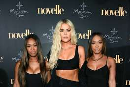 UNCASVILLE, CT - JUNE 22: (L-R) Khadijah Haqq McCray, Khloe Kardashian and Malika Haqq walk the red carpet at the official grand opening party for Mohegan Sun's new ultra-lounge, novelle, on Saturday, June 22, 2019, in Uncasville, Connecticut. (Photo by Dave Kotinsky/Getty Images for Mohegan Sun)