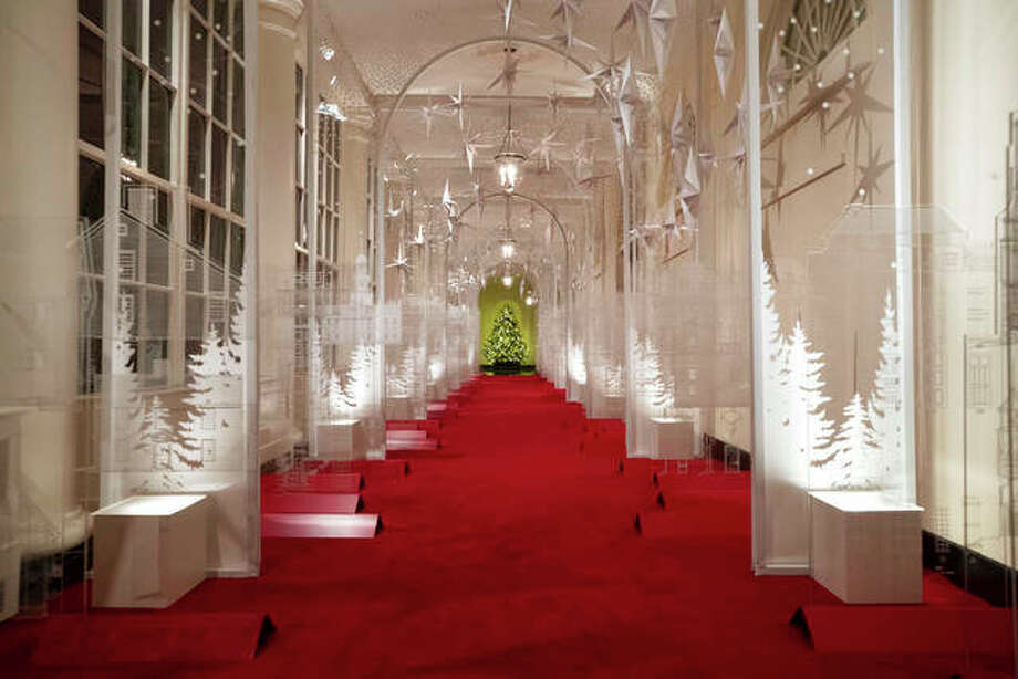 """The East Colonnade is decorated with a timeline of American design, innovation and architecture during the 2019 Christmas preview at the White House, Monday, Dec. 2, 2019, in Washington. This year's theme is, """"The Spirit of America."""" Alex Brandon 