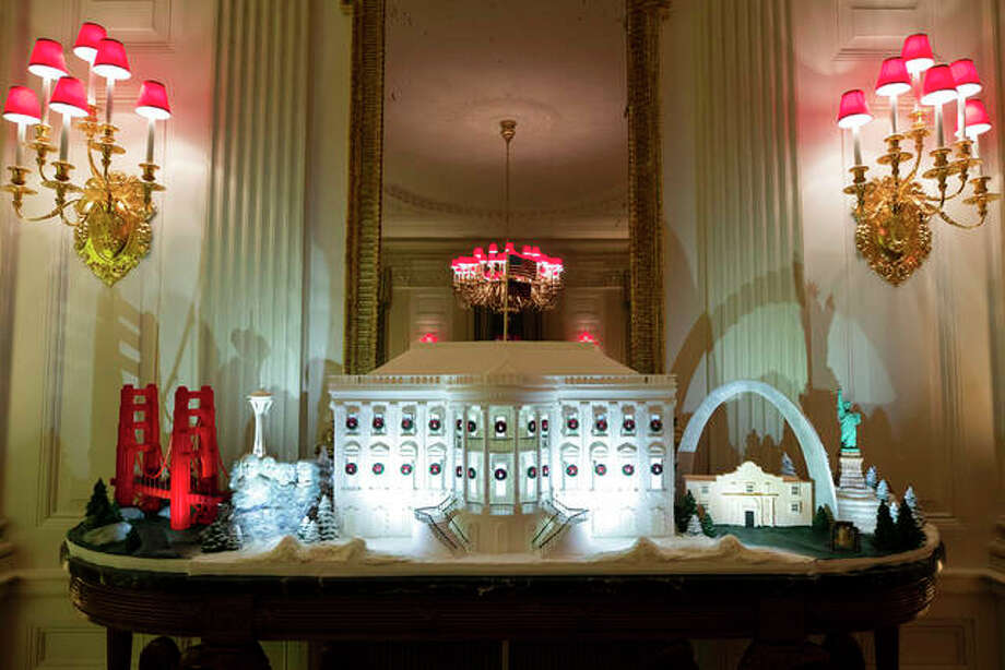 The White House made of gingerbread also features landmarks from around the country in the State Dinning Room during the 2019 Christmas preview at the White House, Monday, Dec. 2, 2019, in Washington. Alex Brandon | AP