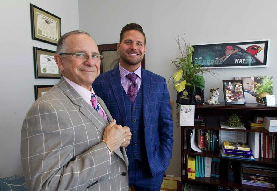 Lawyer Gerald Bourque, left, poses for a portrait beside his son, Morgan, at their office in The Woodlands, Friday, June 28, 2019, in The Woodlands. The father and son duo are working as criminal defendants. Gerald recently won a capital murder acquittal in Montgomery County and was named the Harris County Criminal Lawyers Association's lawyer of the year for the case. Morgan, a former Montgomery County assistant district attorney, primarily works out of the Montgomery County Courthouse. Photo: Jason Fochtman, Houston Chronicle / Staff Photographer / Houston Chronicle