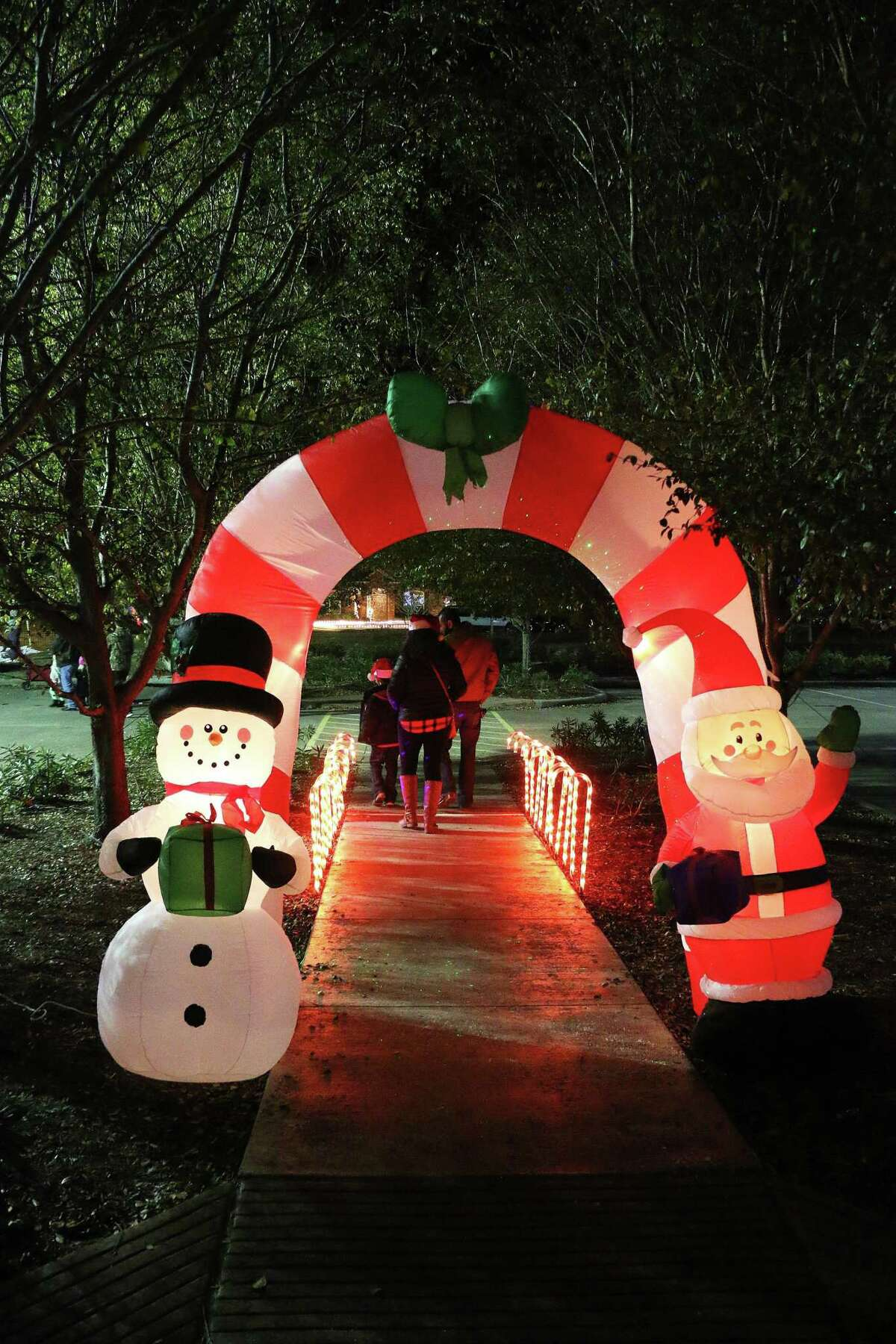 This walkway with Santa and Frosty became a special place for photo ops for festival goers at the Spirit of Christmas celebration last year outside the Dayton Community Center.