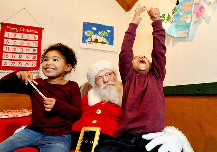 John Gordon, 3, of Glen Carbon, right, shouts for joy alongside his sister Elizabeth, 5, on Saturday during Santa at City Park in Edwardsville. Santa at City Park is in its eleventh year, and is presented by the Edwardsville Parks & Recreation Department. Visitors are welcome to visit Santa on Wednesdays from 5:30 to 8:30 p.m. and Saturdays from 1 to 4 p.m. until Dec. 21. Parents are encouraged to take photos while their children greet Santa Claus inside his decorated home at City Park, located at 101 S. Buchanan St. Families were able to see Santa arrive in a big red fire truck Saturday, courtesy of Edwardsville Fire Department. Photo: Thomas Turney|For The Intelligencer