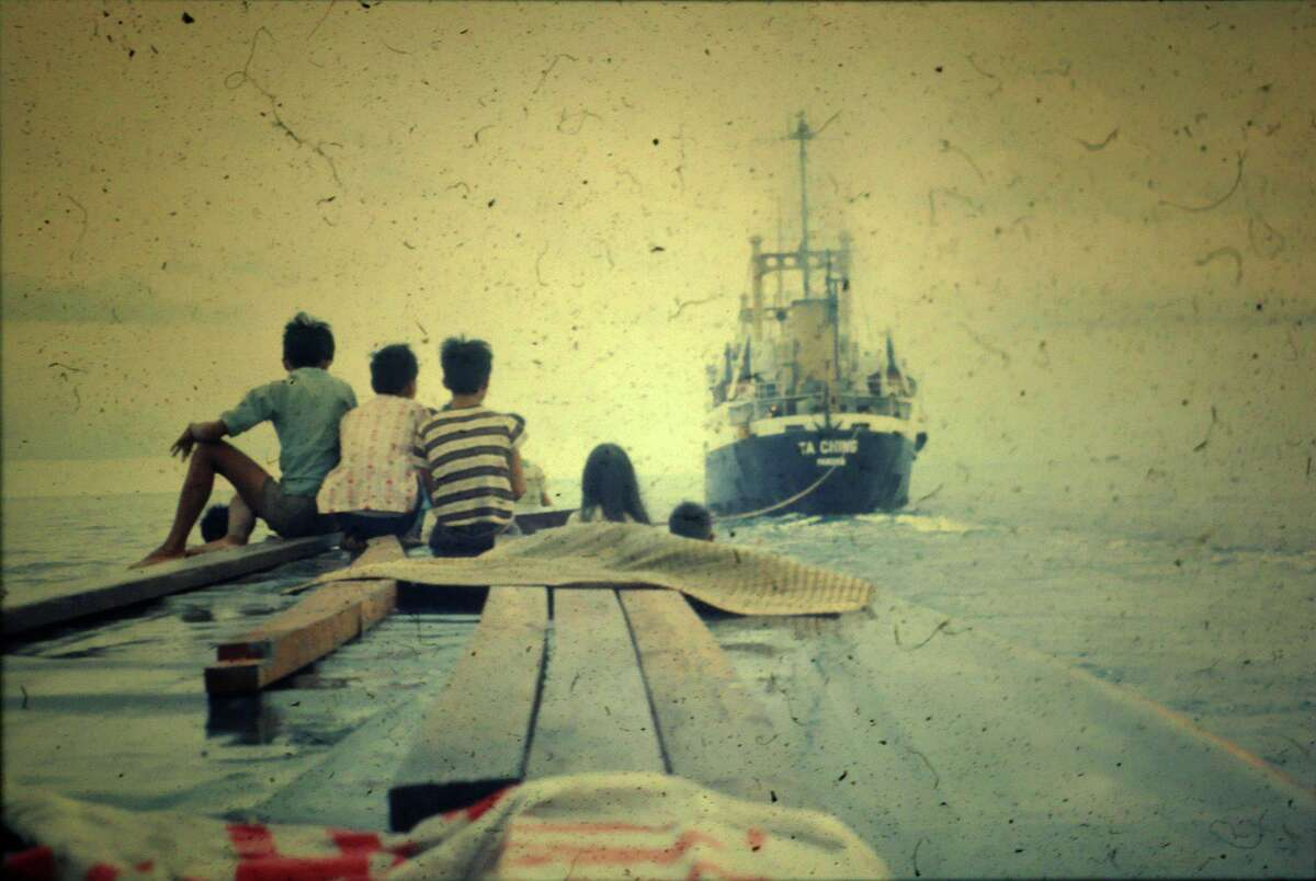 Taken the day they left Vietnam in Cam Rahn in April 1975, this photo shows the boat theCamranh Christian Orphanage bought to sail to an island to wait out the war. A day into their estimated two-day journey the boat motor broke and five days later they were brought into a harbor in Singapore by a tanker.