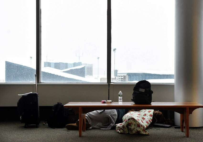 Delayed air travelers take refuge in the Observation Deck at Albany International Airport as a slow-moving snowstorm sweeps through the Capital Region on Monday, Dec. 2, 2019, in Colonie, N.Y. (Will Waldron/Times Union)