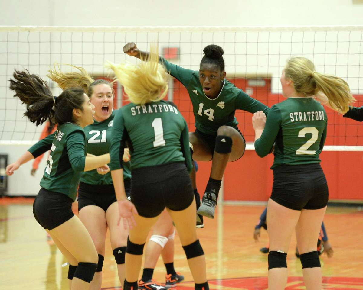 Stratford celebrates a point in the first set of a high school volleyball match between the Stratford Spartans and the Bush Broncos during the 2018 Katy / Cy-Fair Volleyball Classic on August 9, 2018 at Katy High School, Katy, TX.
