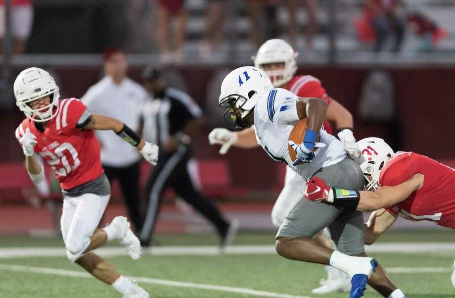 Trinity Christian Tigers Wide Receiver, Rodrick Weaver (11) is brought down by St. Thomas Eagles Linebacker, Cooper Thomas (31) in a high school football game on Friday, September 27, 2019 at St. Thomas High School's Granger Stadium in Houston Texas. Photo: Wilf Thorne / Contributor / © 2019 Houston Chronicle