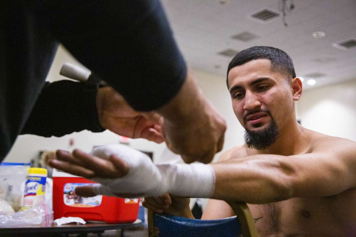 Joseph Rivera, 22, gets his wrists wrapped before a boxing match against Ariel Vasquez on Saturday, Nov. 23, 2019, in Houston.